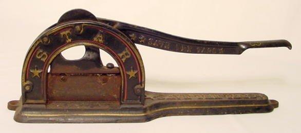 1310: Cast Iron Star Tobacco Cutter NR
