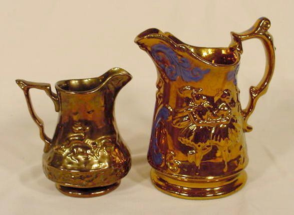 1017: 2 Copper Lustre Relief Decorated Pitchers NR