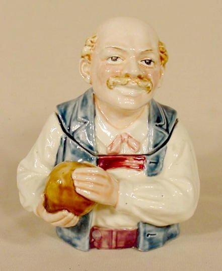 1022: Majolica Figural Bald Man Holding Ball Humidor NR