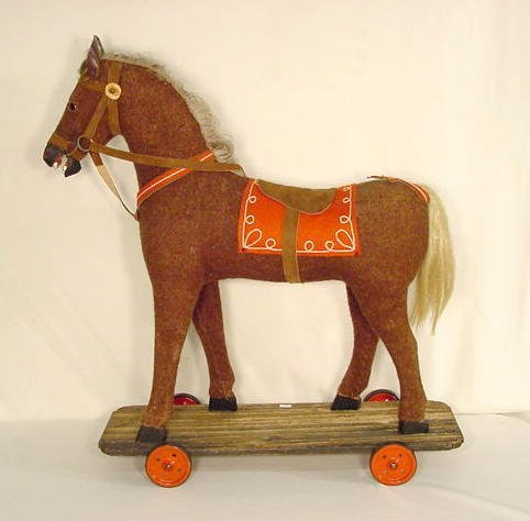 22: Hobby Horse Style Pull Toy on Wheels NR