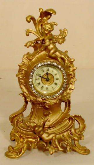 51: Ansonia Cherub Figural Metal Case Clock NR