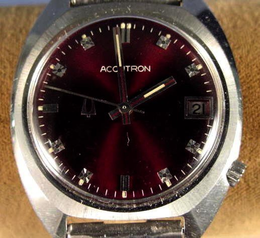 1815A: Bulova Accutron Date Maroon Dial Wrist Watch NR