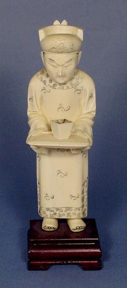19: Carved Ivory Figure of a Man Holding a Tray NR