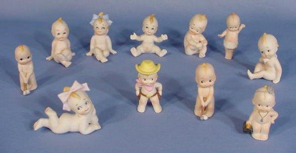 1: Group of 11 Bisque Unmarked Kewpie Figurines