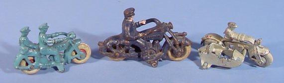 519: Three Cast Iron Toy Motorcycles