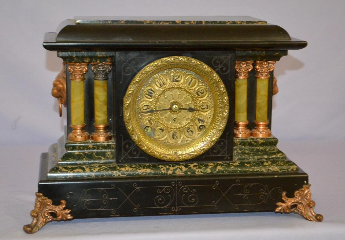 Seth Thomas Mantel Clock. Lion heads on side, w/ metal