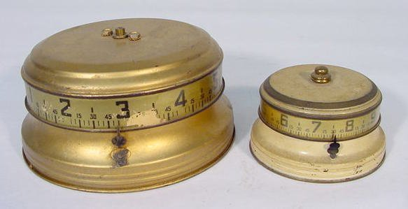 517: 2 U.S.A. Tape Measure Clocks