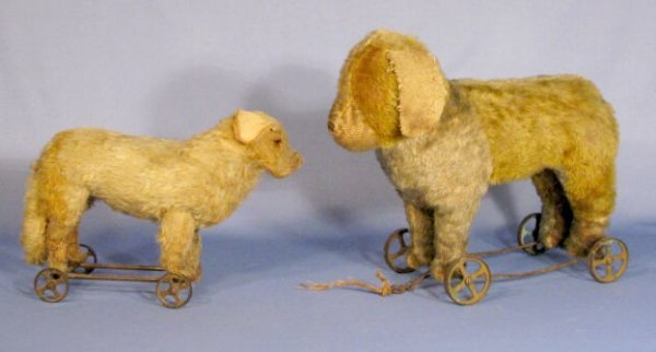 512: 2 Straw Stuffed Dogs on Wheeled Bases