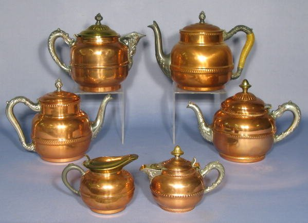 699: 4 Copper Tea Pots & 2 Copper Creamers