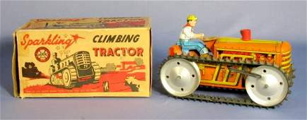 720: Tin Toy Wind Up Sparkling Climbing Tractor in Box