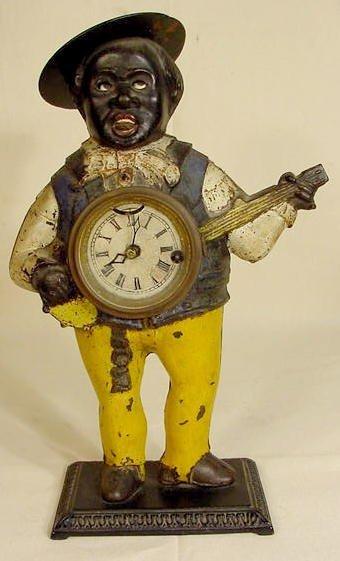 10: Cast Iron Blinking Eye Black Banjo Player Clock