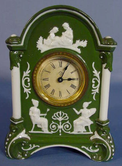16: Ansonia Porcelain Clock w/White Figures in Relief