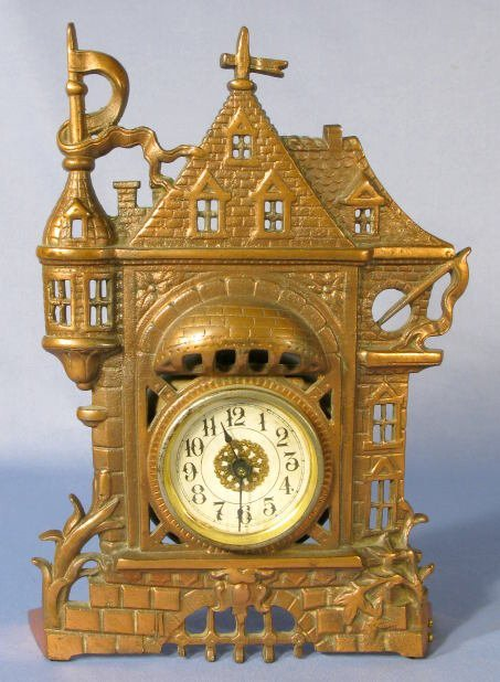 24: Cast Iron Novelty Clock Formed as a Castle