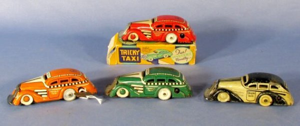 12: Group of 4 Marx Tin Key Wind Tricky Taxi Car Toys