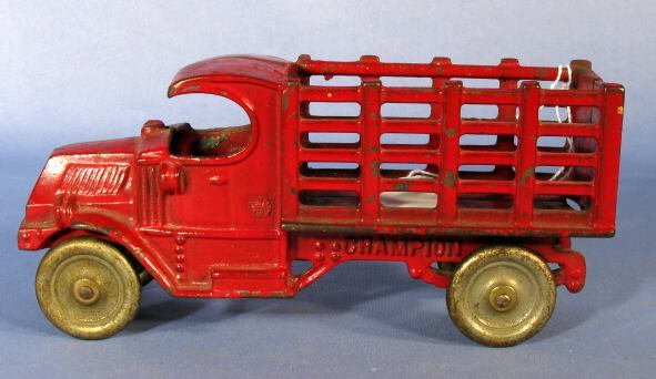 16: Champion Stake Truck Cast Iron Toy