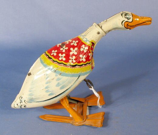 24: Unique Art Pecking Duck Tin Windup Toy
