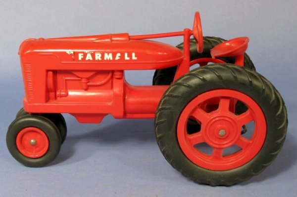 228: Farmall Red Hard Plastic Toy Tractor