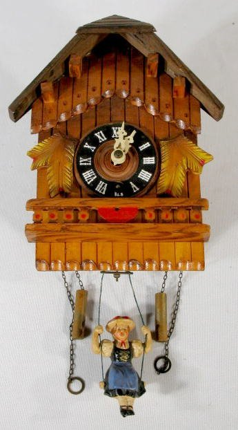 2: Carved Wood Clock w/Swinging Doll