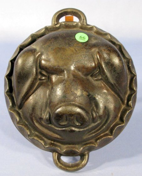 66: Cast Iron Pig Head Mold