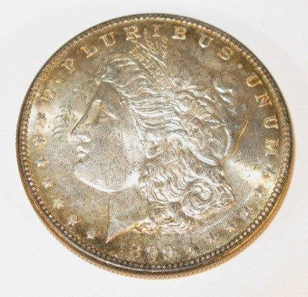 12: Coin - 1899P Morgan Dollar- MS-60- Toned Edge