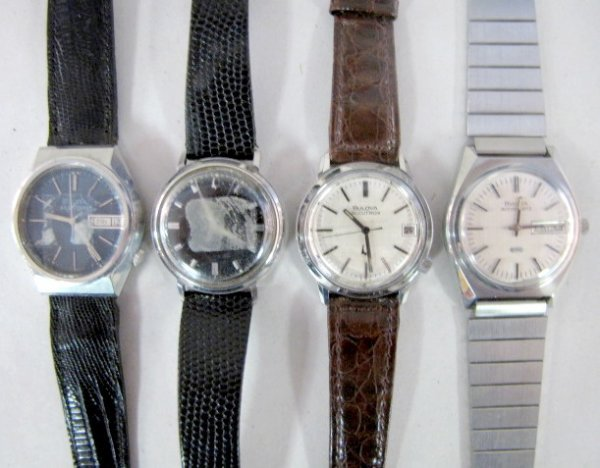 6: Group of 4 Bulova Stainless Steel Wrist Watches