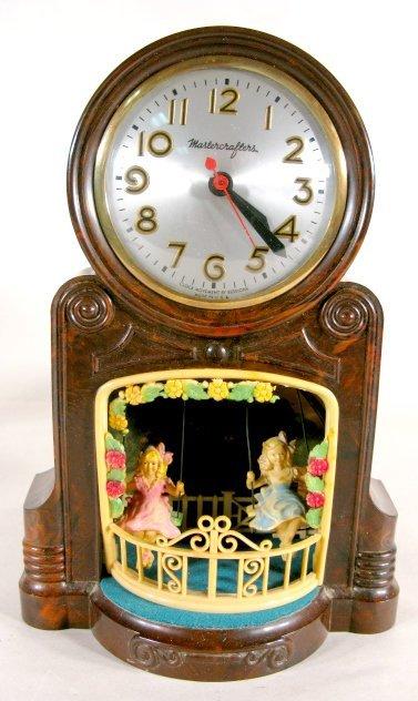 8: Mastercrafters Electric Swinging Dolls Clock