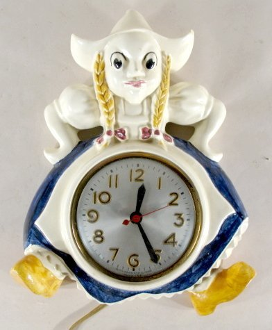 19: Pottery Dutch Girl Electric Wall Clock