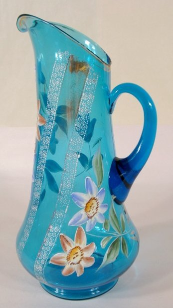 6: Floral Enamel Decorated Blue Pitcher