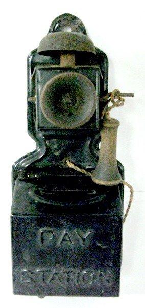 "20: Tin ""Pay Station"" Telephone Bank"