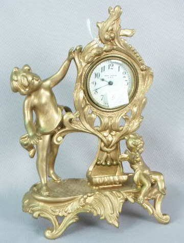 1001: New Haven Metal Clock with Figural Cupid NR