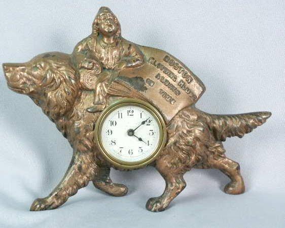 1002: Boston Clothing Metal Figural Advertising Clock