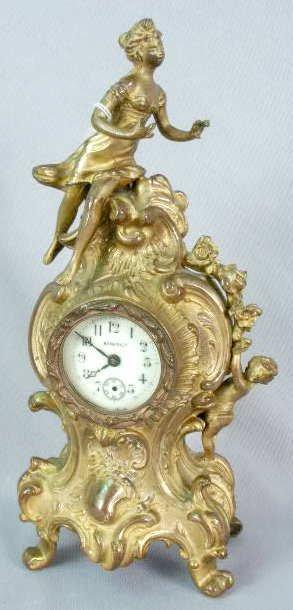 1003: Ms. Benedict Mfg Co Metal Case Figural Clock NR