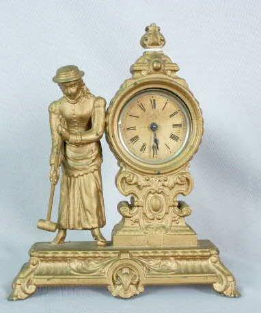 1004: Ansonia Metal Clock w/ Figural Woman & Croquet NR