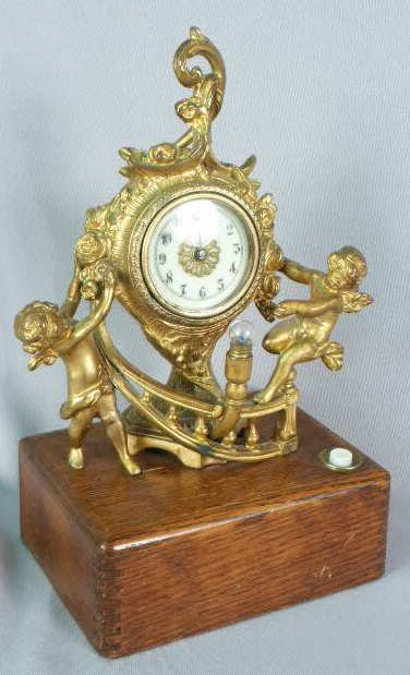 1026: Waterbury Metal Case Clock w/ 2 Cherubs NR