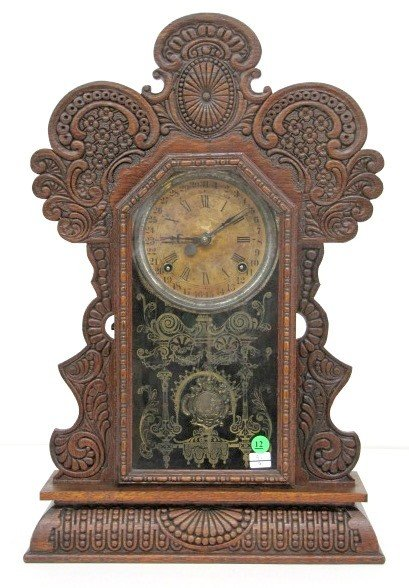 12: Oak Pressed Carved Calendar Kitchen Clock