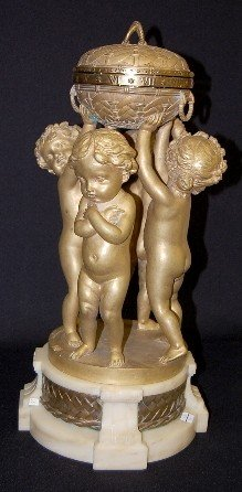 160: French Annular Bronze Cherub Statue Clock