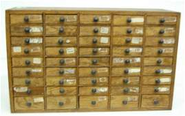 387A: Multi Drawer Oak Cabinet With Misc. Parts