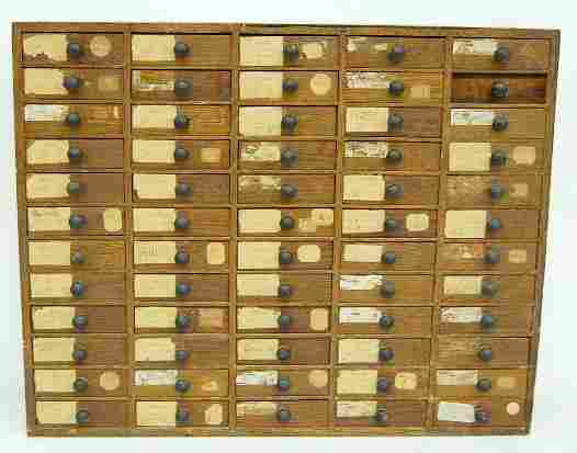 Oak 60 Drawer Parts Cabinet With Misc. Parts