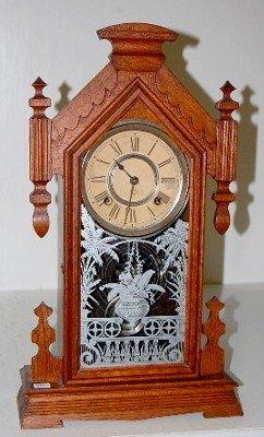 """18: Ansonia """"Africa"""" Oak Kitchen Clock: T&S"""