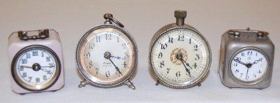2A: 4 Small Metal Dresser Clocks