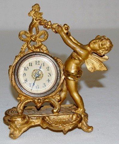 36A: Metal Novelty Cherub Figural Dresser Clock