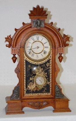 37: Ansonia Walnut Egyptian Head Parlor Clock