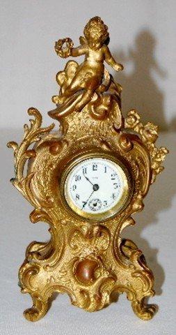 42A: Metal Novelty Figural Cherub Dresser Clock