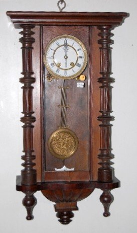 76: Carved RA Wall Hanging Clock