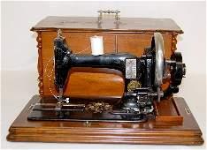 98F: Antique Walnut Cased Sewing Machine