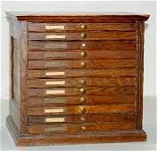 214: 12 Drawer Antique Oak Parts Cabinet