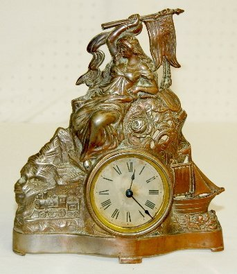 7: Metal Clock with Lady, Flag, Train and Ship