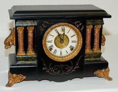 9: Antique Ornate Black Mantel Clock