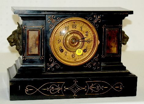 94: Ansonia Iron Case Clock With Lion Heads