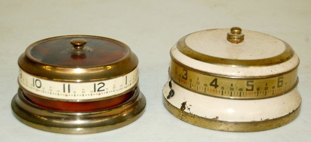 10: 2 Tape Measure Clocks, U.S.A. & German